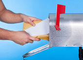 Man opening his mailbox to remove mail — Foto Stock