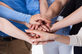 Group of people stacking hands together — Stock Photo