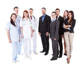 Large ground of doctors and managers — Stock Photo