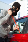 Thief In Hooded Jacket And Balaclava Opening Car's Door — Stock Photo