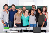 Confident College Students Standing Together In Classroom — Photo