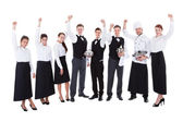 Large group of waiters and waitresses cheering — Stock Photo