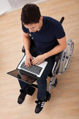 Handicapped Man Using Laptop On Wheelchair — Stock Photo