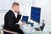 Hardworking businessman at his desk — Stock Photo