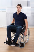 Handicapped Man Sitting On Wheelchair At Home — Stock Photo