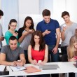 University Students Using Mobile Phones — Stock Photo #43674255