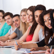 College Students Sitting In A Row At Desk — Stock Photo #43674309