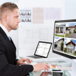 Businessman checking a property portfolio online — Stock Photo #43674475