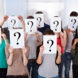 University Students Holding Question Mark Signs — Stock Photo #43674527