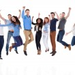 Group of diverse people raising arms and jumping — Stock Photo #43674595