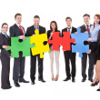 Group of businesspeople holding puzzle pieces — Stock Photo
