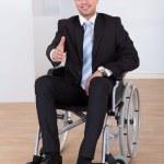 Businessman In Wheelchair Offering Handshake — Stock Photo #43675033