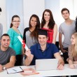 College Student Holding Degree With Classmates Looking At Him — Stock Photo