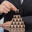 Businesswoman Stacking Wooden Team Blocks — Stok fotoğraf #43675315