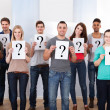 College Students Holding Question Mark Signs — Stock Photo #43675411