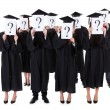 Graduate students showing question signs — Stock Photo