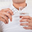 Man With Pack Of Pills And Water Glass — Stock Photo #43676421