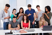 University Students Using Mobile Phones — Stock Photo