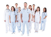 Large diverse group of medical staff in uniform — Stock Photo