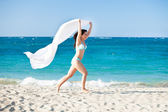 Woman With Sarong Running On Beach — Stock Photo