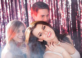 Women Dancing With Friends At Nightclub — Stock Photo