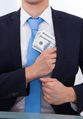 Businessman Putting Bribe Money In Pocket — Stock Photo