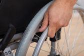 Handicapped Man's Hand Pushing Wheel Of Wheelchair — Stock Photo
