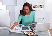 Photo Editor Working At Office Desk — Stock Photo