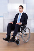 Confident Businessman Sitting On Wheelchair — Stock Photo
