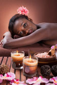Smiling young woman relaxing at beauty spa — Photo