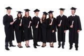 Group of student graduates with their diplomas — Stock Photo