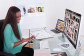 Editor Using Digital Tablet At Photo Agency — Stock Photo