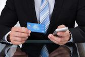 Businessman doing online banking — Photo