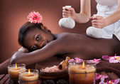Woman Enjoying Herbal Massage At Spa — Foto Stock