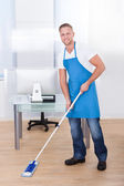 Janitor cleaning the floor in an office building — Stock Photo