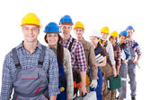 Large group of construction workers queuing up — Stock Photo