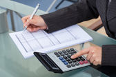 Businesswoman Calculating Tax — Stock Photo