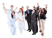 Doctors and managers raising arms — Stock Photo