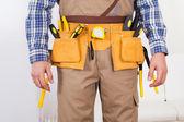 Man Wearing Tool Belt At Home — Stock Photo
