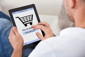 Conceptual image of a man making an online purchase — Stock Photo