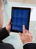 Businessman navigating on his tablet-pc — Stock Photo