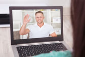 Video conferencing with friend on laptop from home — Stock Photo