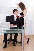 Undressed Businesswoman Pulling Boss Towards Self In Office — Stock Photo