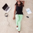 Woman Relaxing On Rug At Home — Stock Photo #44069713