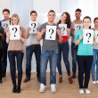 College Students Holding Question Mark Signs — Stock Photo