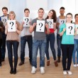 College Students Holding Question Mark Signs — Stock Photo #44069065
