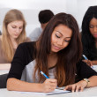 Female College Student Sitting In Classroom — Stock Photo #44069805