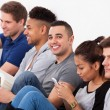 Happy College Student Sitting With Classmates — Stock Photo #44069835