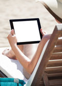 Woman Using Digital Tablet On Beach Chair — Stock Photo