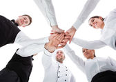 Waiters and waitresses stacking hands — Stock Photo